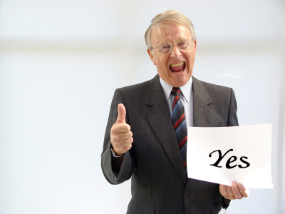 Man holding a YES sign