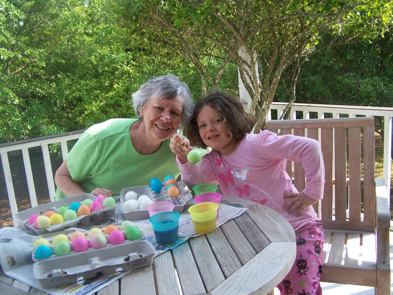 photo of Mama Liz and granddaughter, Eliza on porch at Easter time