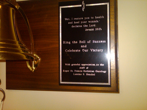 the bell at Roper Radiation Center with the plaque