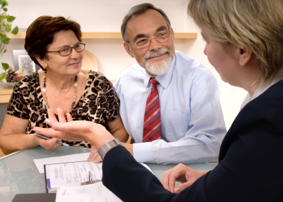 photo of Realtor explaining contract to clients