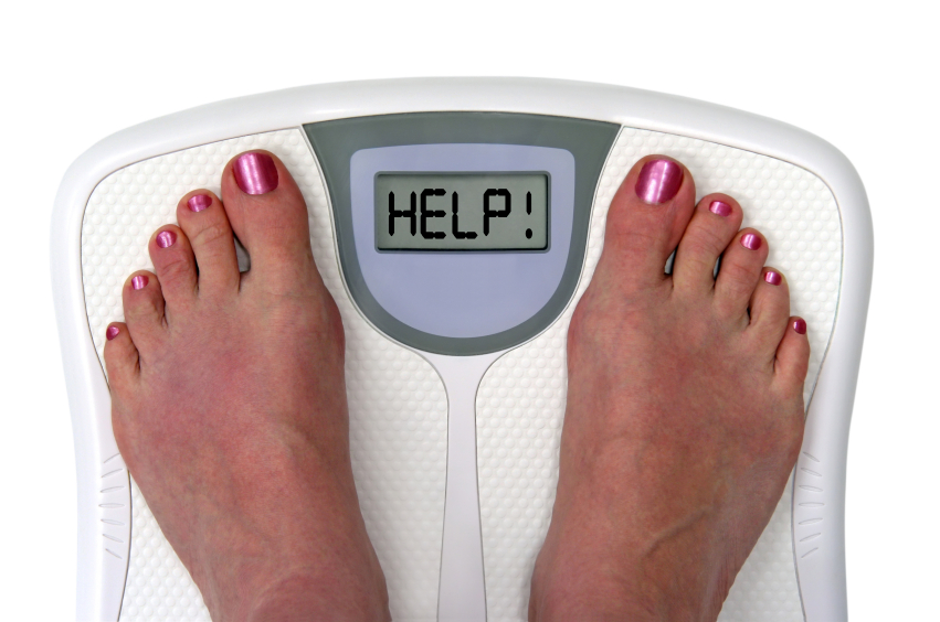 Scales with a woman's feet on it